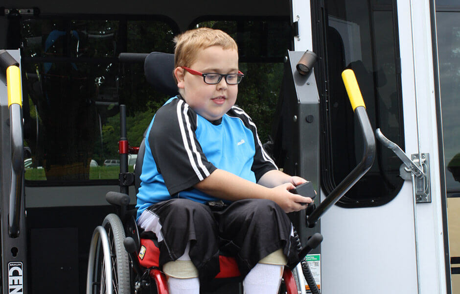 child in wheelchair exiting accessible van
