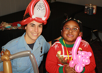 Fire Fighter and Kamaria at Holiday Party